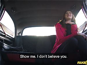 little red-haired Linda pays for her taxi with her slit