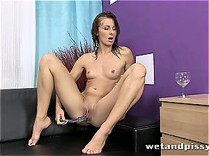 dark-haired with puny tits pisses when draining