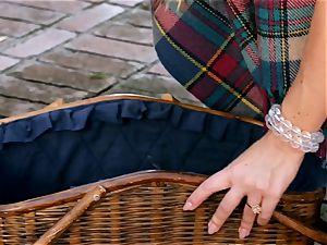 uber-cute Nicole Aniston dips her dildo outdoors