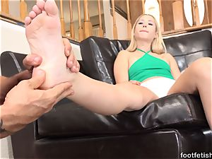 Goldie enjoys a Finger in Her arse and providing Footjobs